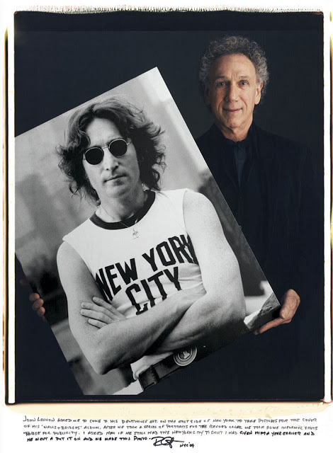 Bob Gruen: John Lennon asked me to come to his pentouse apt. on the east side of New York to take pictures for the cover of his 'Walls + Bridges' album. After we took a series of portraits for the record cover we took some informal shots to use for publicity. I asked him if he still had the New York City t-shirt I had given him a year earlier and he went a put it on and we made this photo.