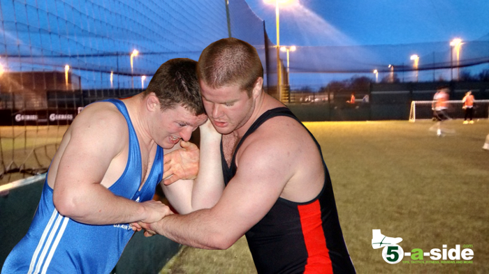 wrestling against fence 5-a-side