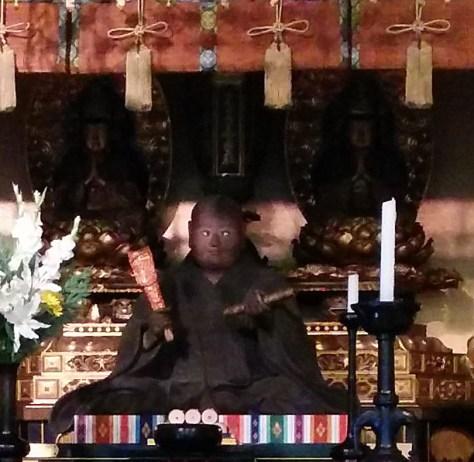 Stupa with Sakyarnuni Buddha and Taho Buddha behind statue of Nichiren