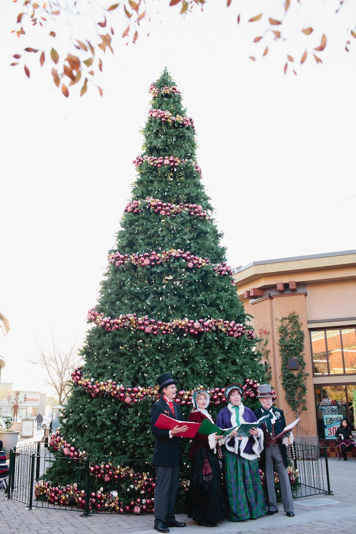 Carolers in front of tree at Alameda South Shore