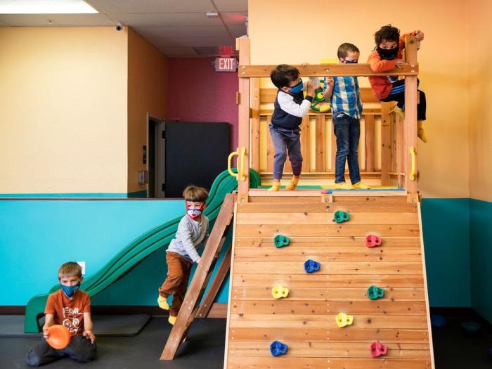 children on climber with slide