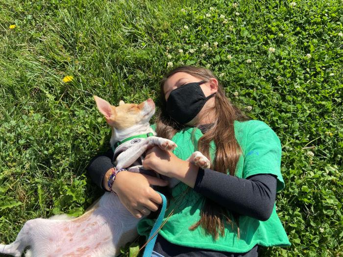 girl and dog play
