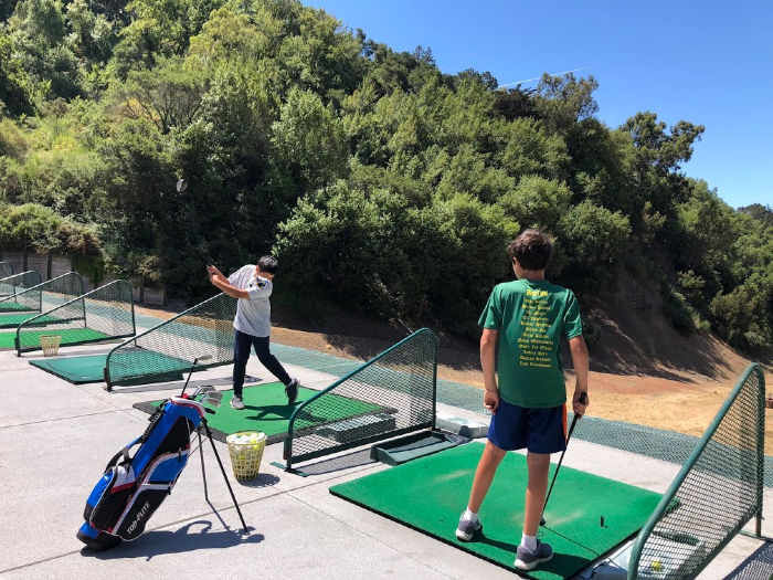 Montclair Golf Course driving range with kids and teens with mask