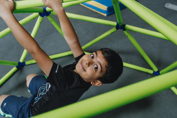 kid climbing at play space