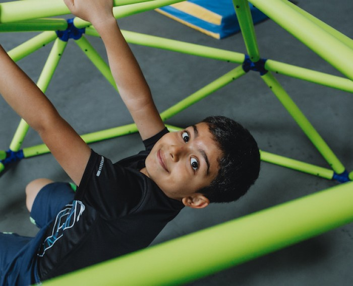 kid swinging at play space