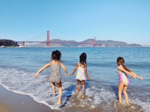 Seeking relief from East Bay heat and enjoying perfect beach weather with clear skies at Chrissy Field Beach | Photo: Julia Gidwani