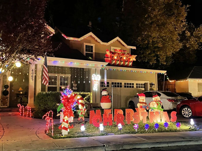 elf christmas scene at candy cane lane