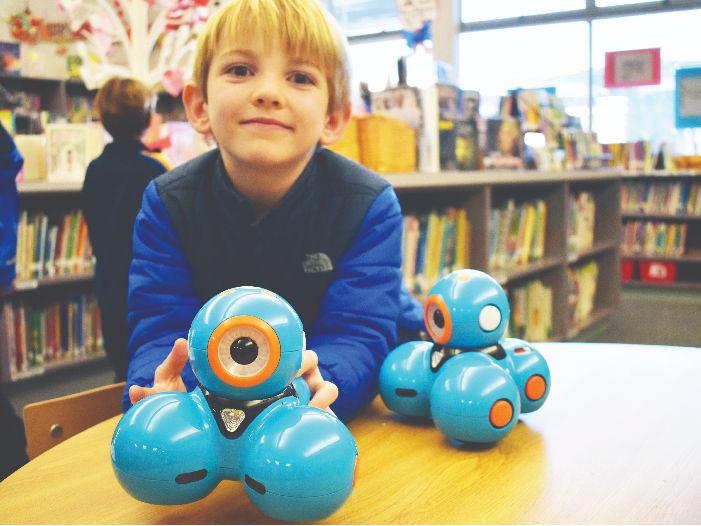 child with wonder robot