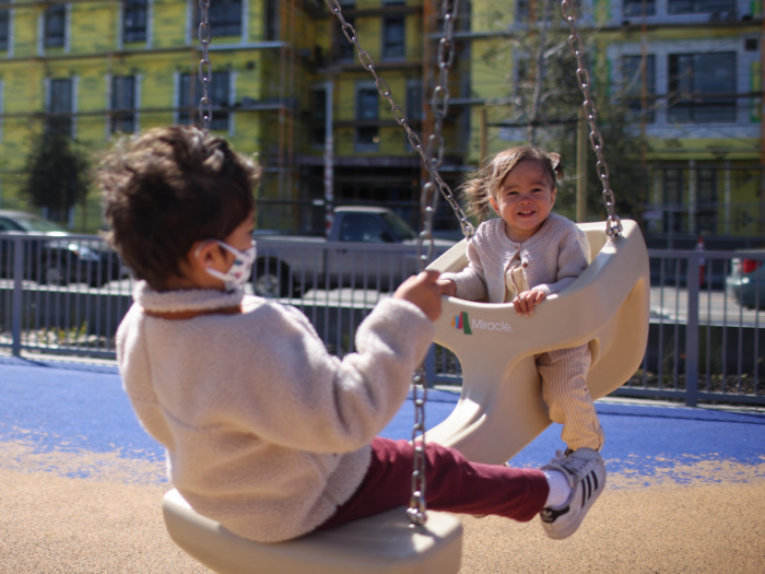 two kids on a fun swing