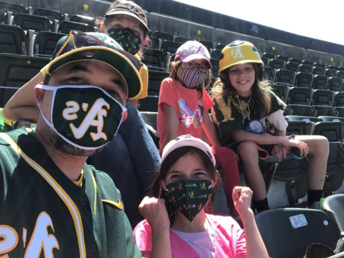 family of five at a's game