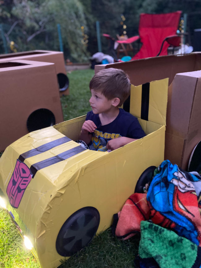 boy in bumblebee car box