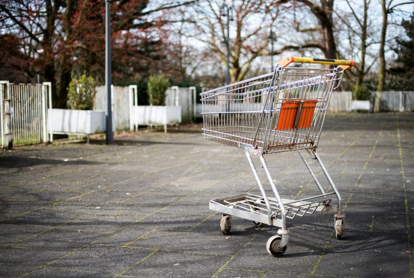lone shopping cart in parking lot