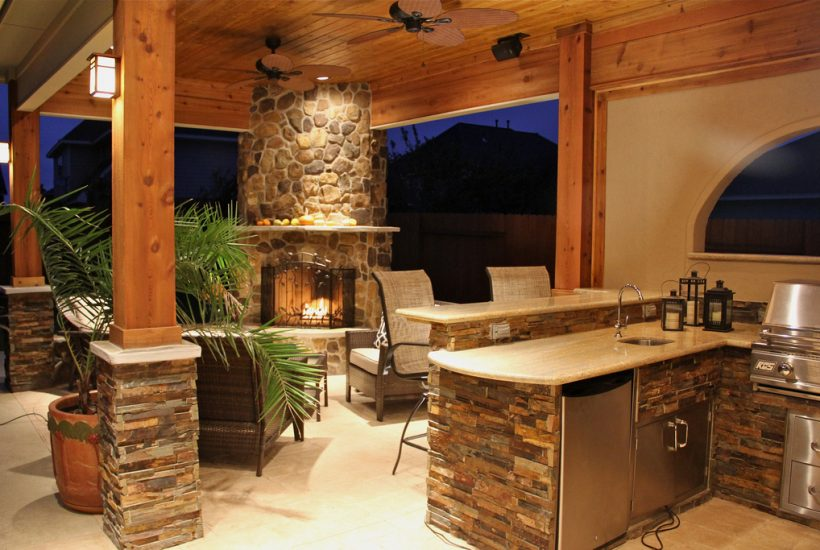outdoor kitchen with furniture and plants