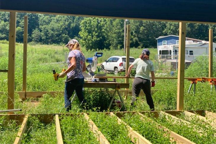 farm crew working on chicken coop
