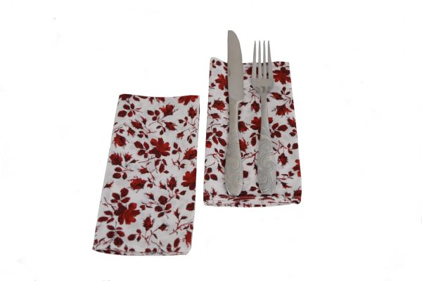 red rose napkins with utensils