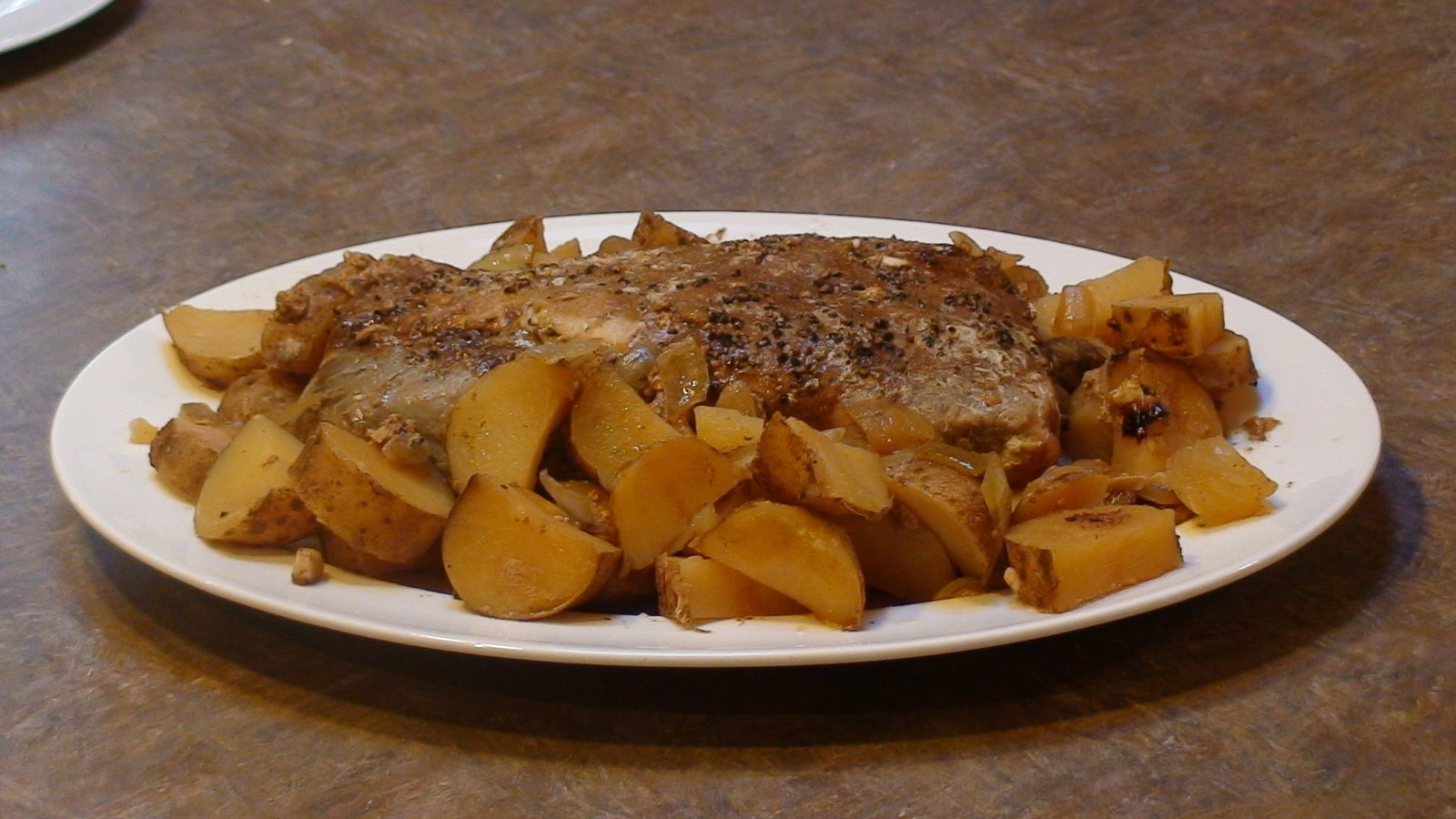 Slow Cooker Pork Roast with Tomatoes, Onions and Potatoes