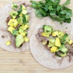 Instant Pot Shredded Beef Tacos with Mango Avocado Salsa from 5DollarDinners.com