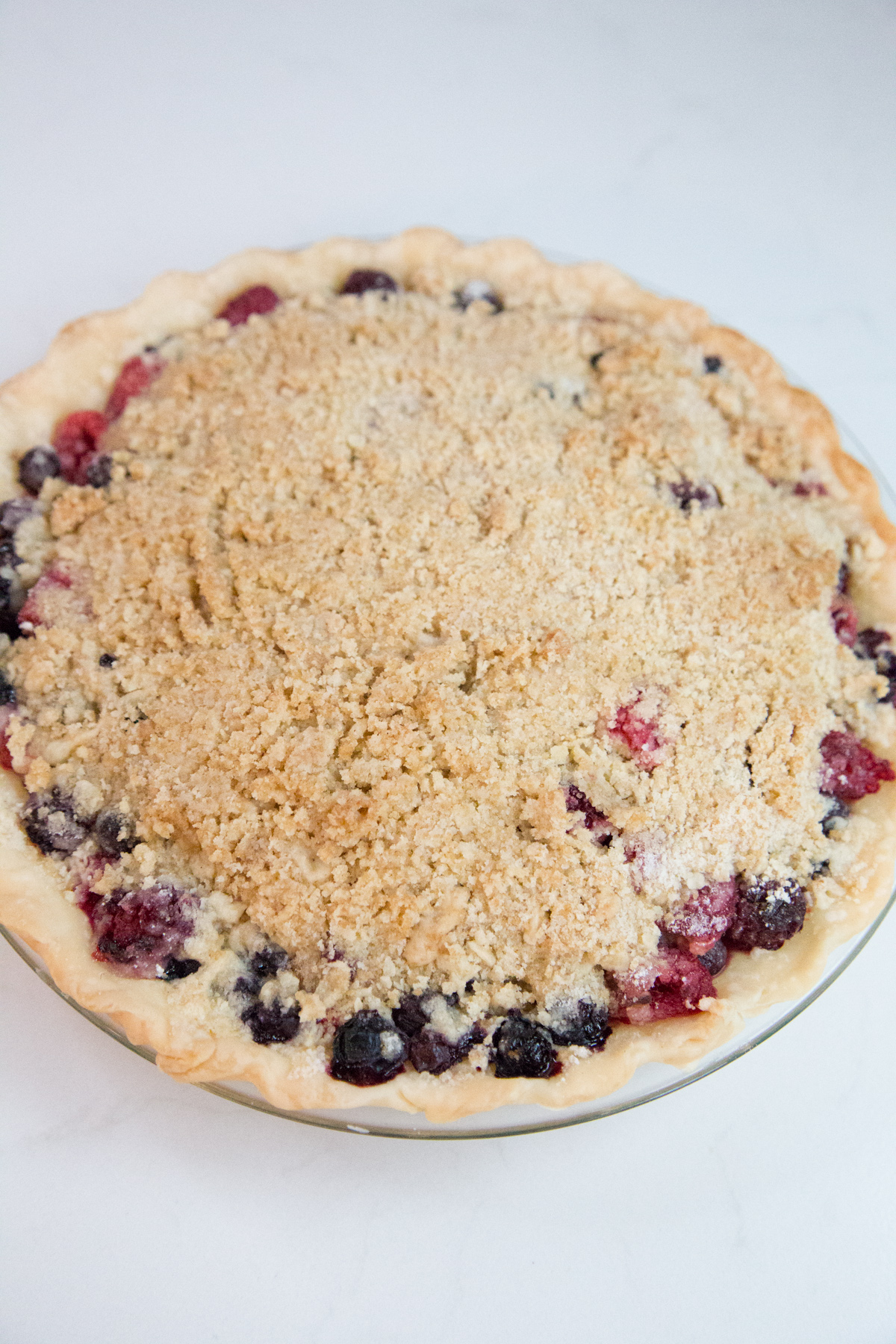 Delicious Berry Crumble Pie recipe - perfect for summer potlucks and BBQs, or a simple dessert after a weeknight dinner.