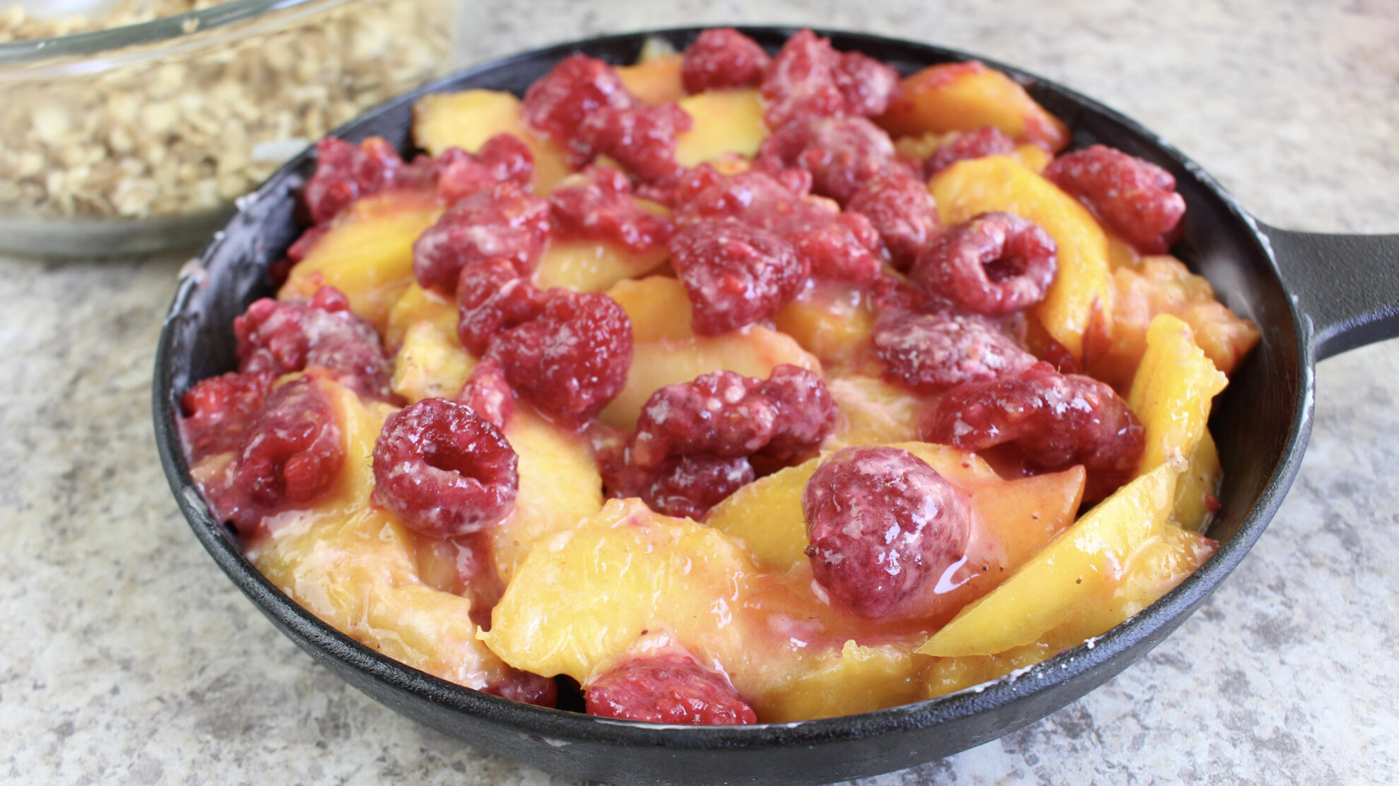 With fall around the corner this Skillet Peach Raspberry Crisp is calling my name and it's the perfect dessert!!! Find it on 5 Dollar Dinners!