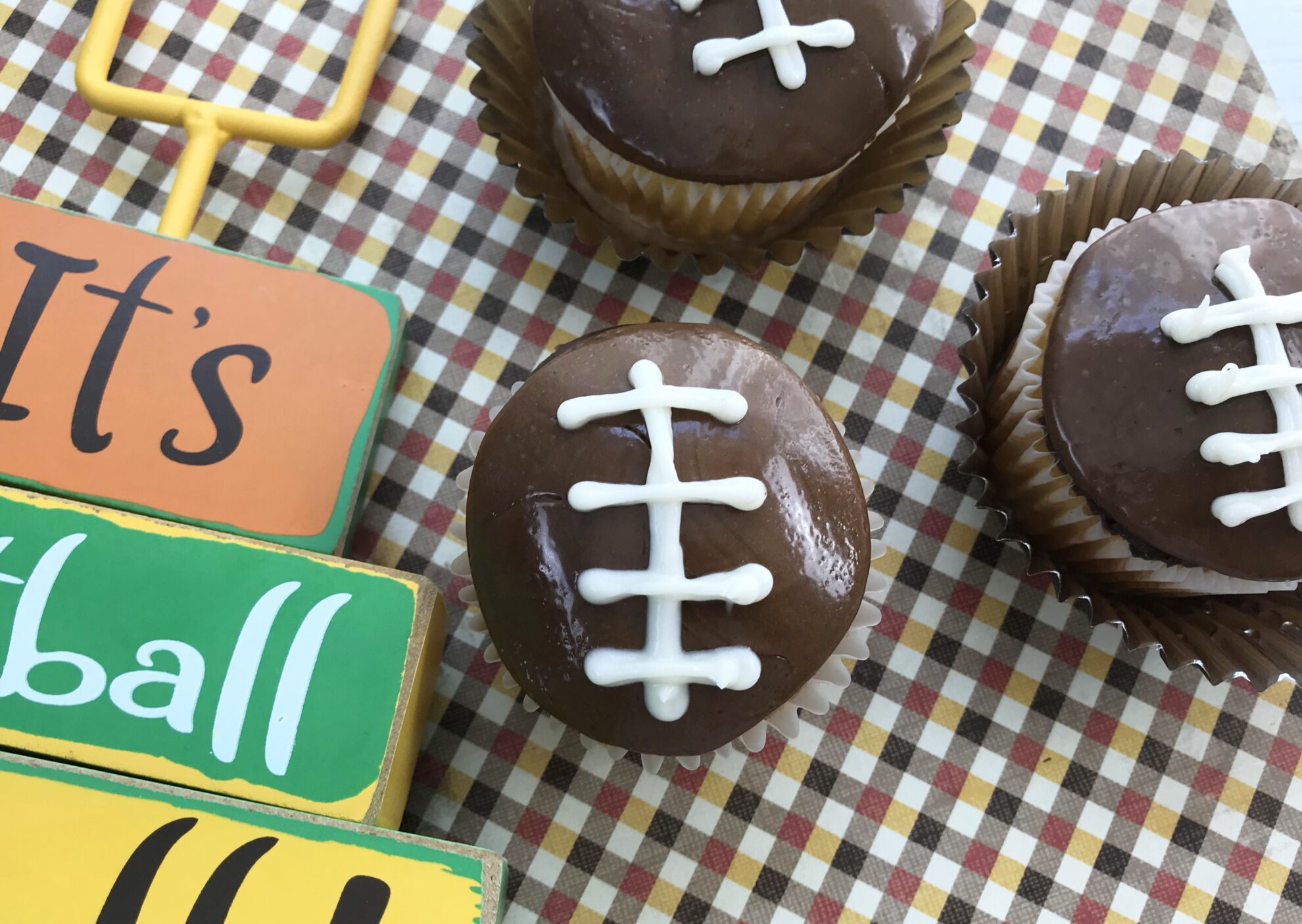 These Football Cupcakes are perfect for Sunday game days!!! The kids will love making these treats and all the info is on 5 Dollar Dinners!