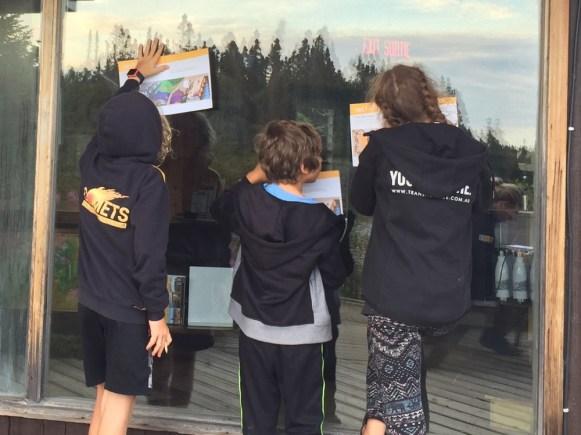 Kids completing Explorer books
