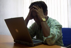 stressed man with laptop