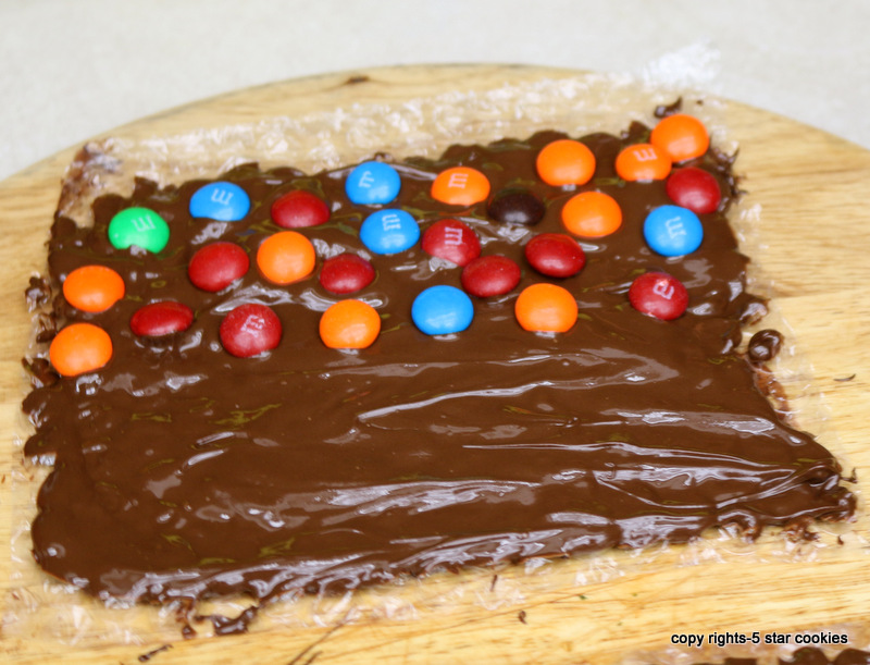 homemade bubble chocolate from the best food blog 5starcookies-spread the chocolate and add M&M