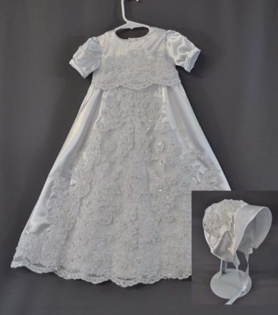 Jolene Sodana sent part of her wedding dress to have a christening gown made for one of her daughters. She loved the lace of her dress and wanted the emphasis to be put on to that. We ended up using a softer satin and taking the lace off the original dress and applying it to the softer satin.