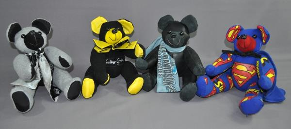 Deb Atwood sent a variety of items including: Superman pajamas, a leather jacket, a dog floatation device and a number of sweat shirts and t-shirts to have these bears made in memory her husband for her grandchildren.