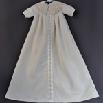 We used some of the lace from the WD on the large, split collar and created a satin band down the front that we put some of the lace trim that came from the hem of the WD.