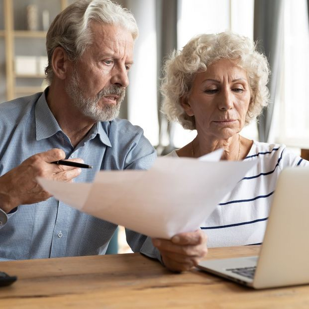 bigstock Elderly Couple Manage Budget H 343180630