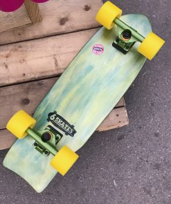 Green and yellow coloured skateboard with green trucks and yellow wheels