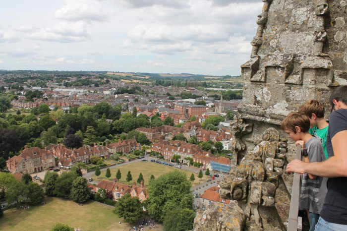 The author's husband and children look down from the top of Salisbury Cathedral over the surrounding countryside.