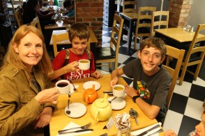 The author and two of her children drink a proper English tea
