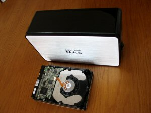 A photo of a NAS box and hard drive