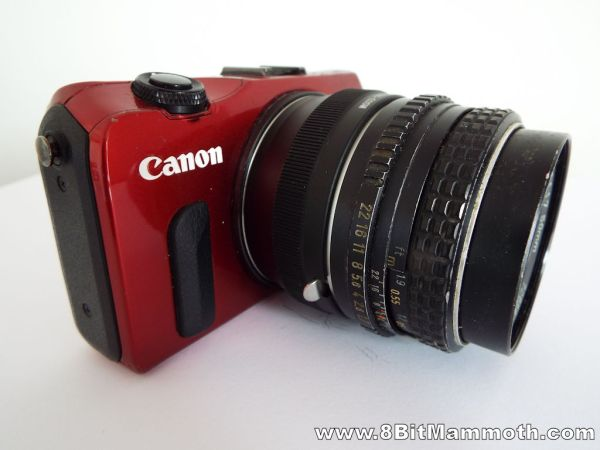 Canon EOS M camera with an adapter and a SMC Pentax-M 50mm lens