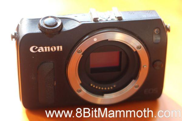 A black Canon EOS M camera