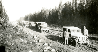 340th Engineers move 70 miles from Carcross to Teslin River on road built by black soldiers of the 93rd Regiment. 1942