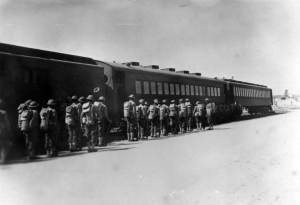 Black soldiers boarding the Rock Island RR at Camp Livingston, LA on their way to build the Alaska Highway 1942.