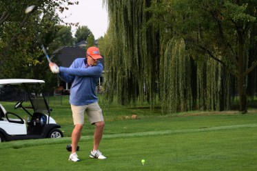 Golfer caught mid-swing