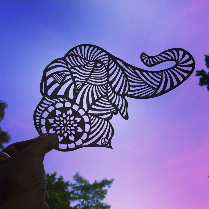 Elephant paper cut art by Jo Chorny