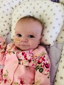 Heartbreaking photos of six-month-old 'miracle baby' who survived open heart surgery and now has Coronavirus
