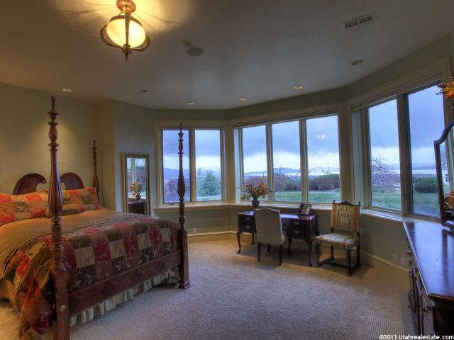 Large opened bedroom with a wall of windows and a beautiful view