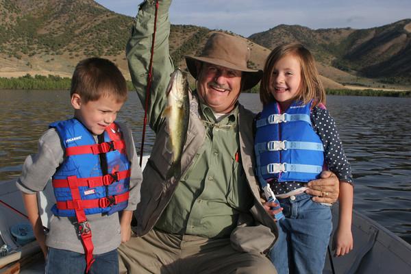 Man fishing with grandchildren