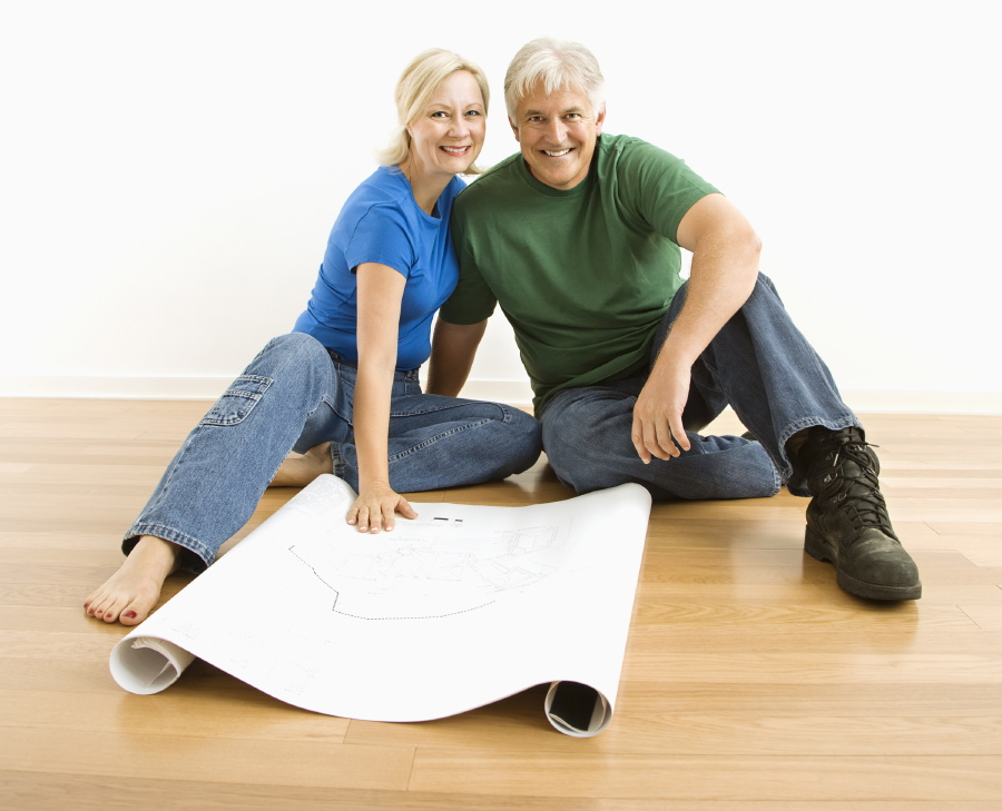 Couple reviewing building plans