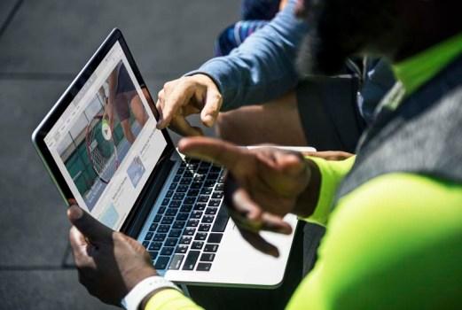 2 men watching a video online