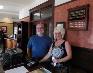 Our front desk hostess, Jerry, and one ghost photo bombs (invisible in the picture but is clearly grinning in the background).