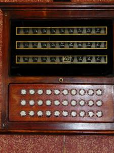 When guests needed room service in 1917, they would push a buzzer in their room and their room number would come up at the front desk on a call board as pictured here. Jerry buzzed for room service (as you can see our room number) but out hostess told us that cell phones make calling her more convenient.