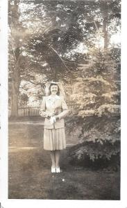 My mom, 1942 (cool hat!)