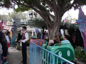 "This is Alex, one of our two tour guides. He is ushering us ahead of the line for the Alice in Wonderland ride. One lady in line commented, ""I think they're V.I.P.'s"" Oh yes! No other reason would make it okay to cut in. Right?"